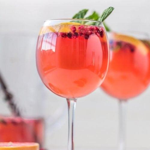 two wine glasses full of sangria