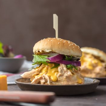 Chicken Rotel Sandwiches are the ultimate way to tailgate for the Super Bowl!  These Slow Cooker Rotel Dip Chicken Sandwiches are the perfect mix of flavors. Spicy Cheesy Chicken Sandwiches made in the crock pot. So easy and so addicting!