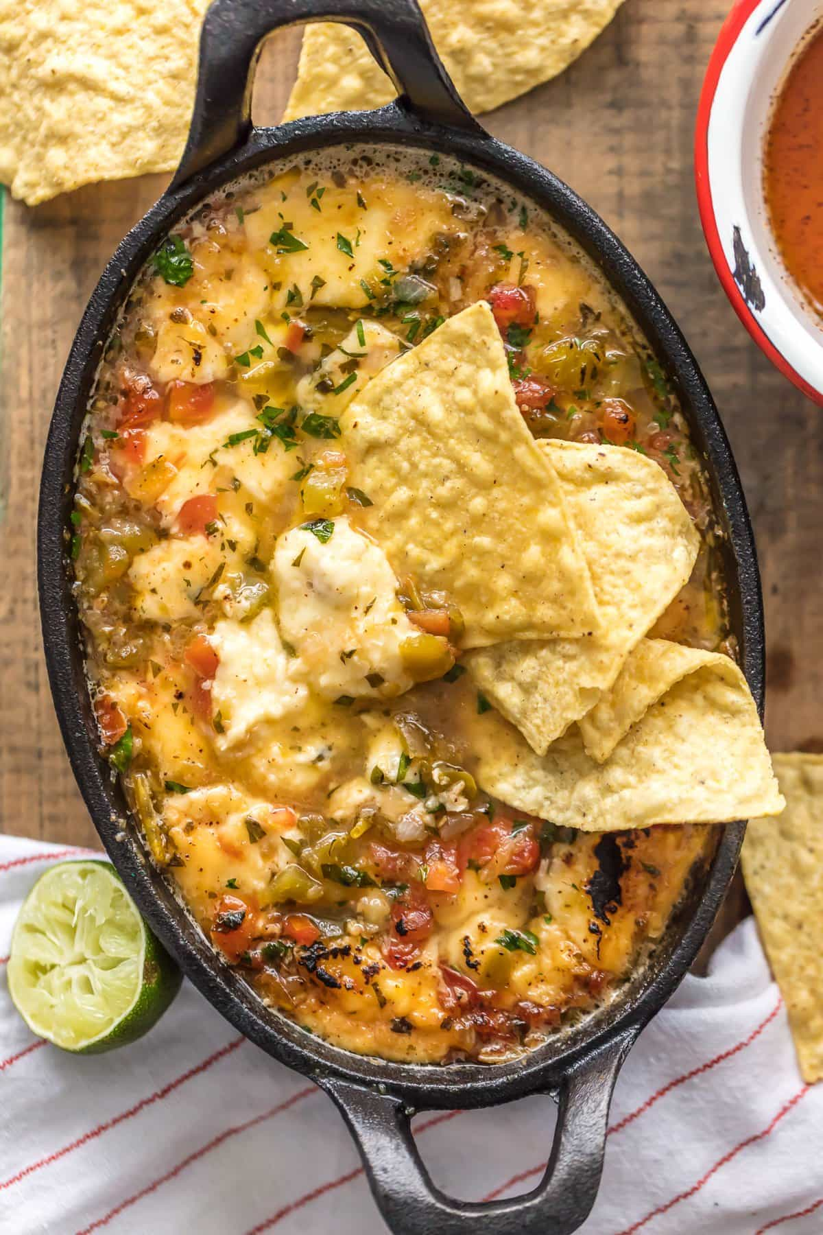 TEQUILA LIME FLAMING QUESO is the most fun way to eat cheese dip! This delicious queso is loaded with pico and green chiles, topped with a chili lime reduction, and then doused in tequila and lit on fire! The ultimate NYE or Super Bowl appetizer!