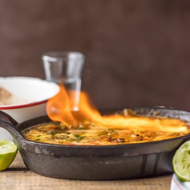 flaming queso dip in a pan