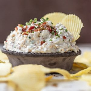 CARAMELIZED ONION DIP is the ultimate super easy appetizer to make for game day! This amazing sour cream and bacon dip is made in minutes and loved by all. It's filled with so much flavor, and so many delicious ingredients, like bacon, sour cream, onions, and chives.