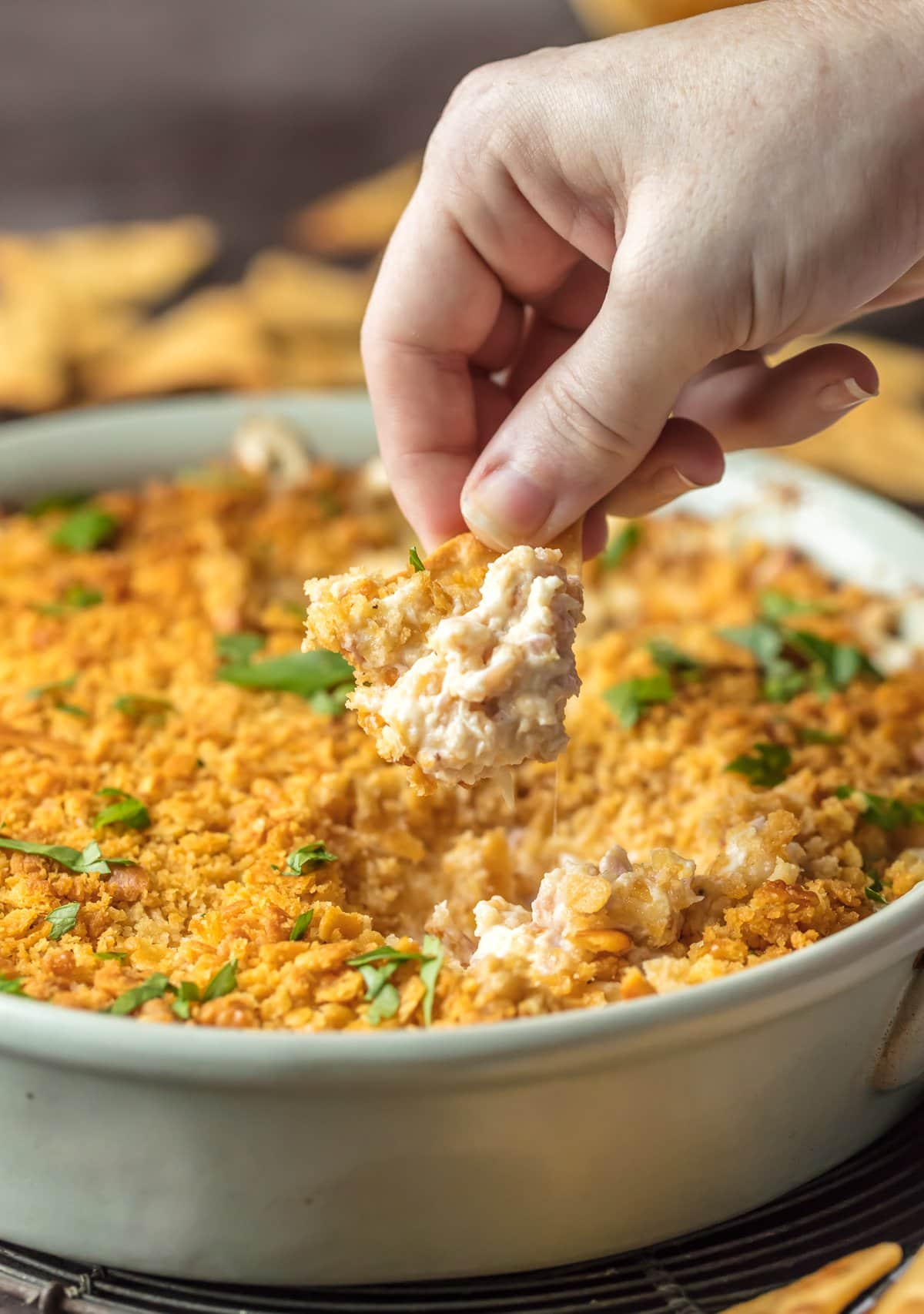Dipping a cracker into chicken cordon bleu dip