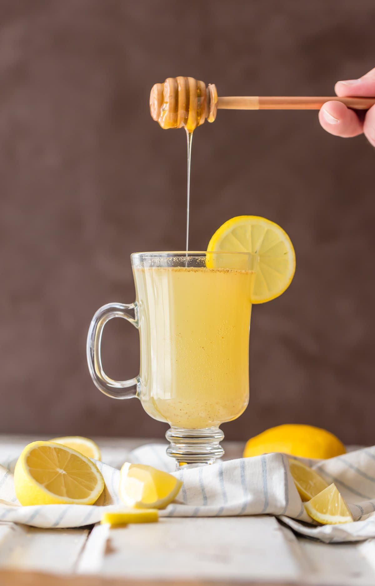 A glass of homemade detox lemonade with honey