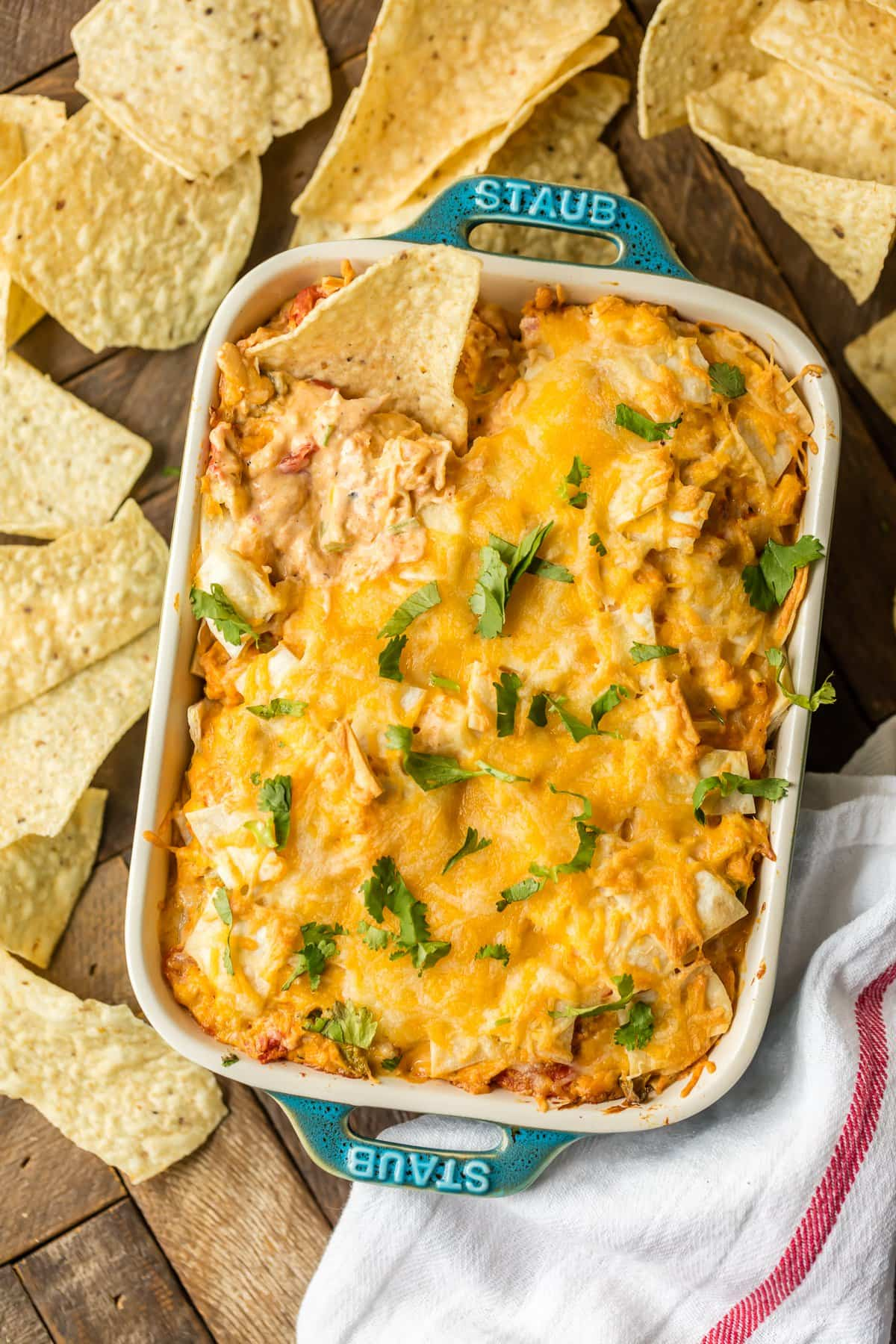 KING RANCH CHICKEN DIP is a fun twist on a classic family favorite casserole. The flavors including chicken, rotel, cheese, and tortillas lend themselves easily to a delicious dip, just perfect for the Super Bowl!