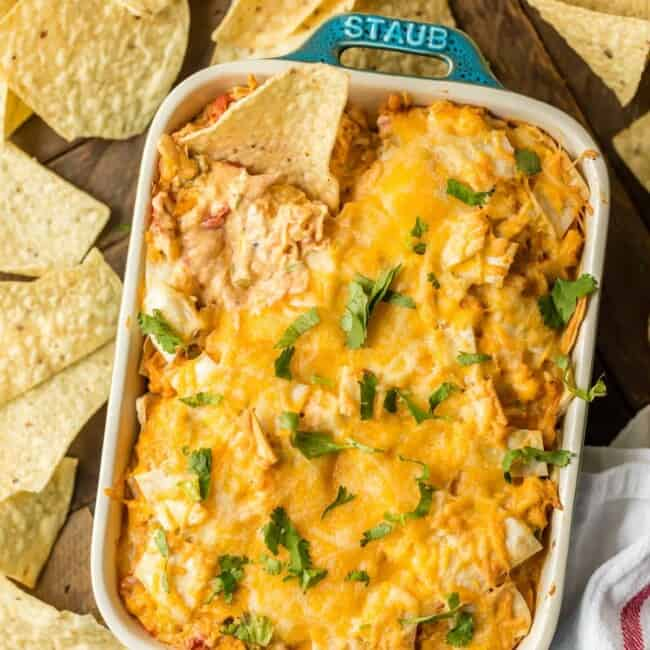 KING RANCH CHICKEN ROTEL DIP is a fun twist on a classic family favorite casserole. The flavors of chicken, rotel, cheese, and tortillas lend themselves easily to a delicious dip. This King Ranch Chicken Dip is just perfect for the Super Bowl!