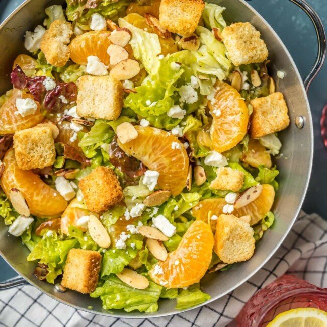 This MANDARIN ORANGE SALAD recipe with ALMONDS AND CIDER VINAIGRETTE has been a favorite in our family forever! My Mom always makes this amazing Mandarin Salad for family dinners and holidays.