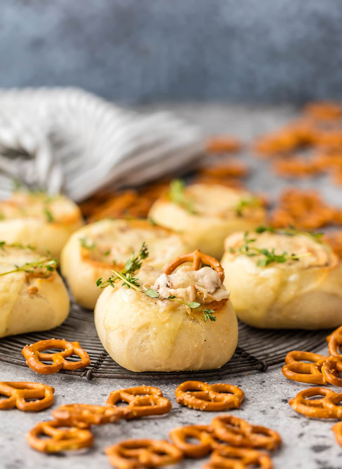These MINI FRENCH ONION DIP BREAD BOWLS are the perfect cute and DELICIOUS appetizer for the Super Bowl! Wow your party guests with French Onion Dip inside mini bread bowls and topped with melty swiss. BEST DIP EVER!