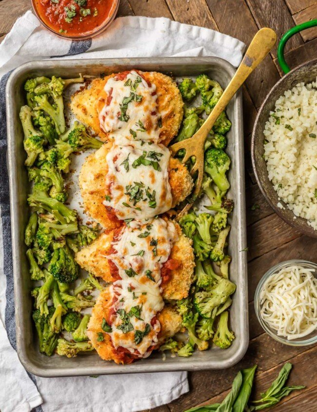 baked chicken parmesan on baking dish with broccoli