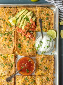 This Chicken Quesadilla Recipe for a crown is made on a sheet pan! Sheet Pan Chicken Quesadillas are the easiest and best way to make delicious quesadillas for a crowd! These baked chicken quesadillas can be made with any filling and toppings, and are sure to please even the pickiest eaters. If you've wondered How to Make Chicken Quesadillas, this recipe is for you!