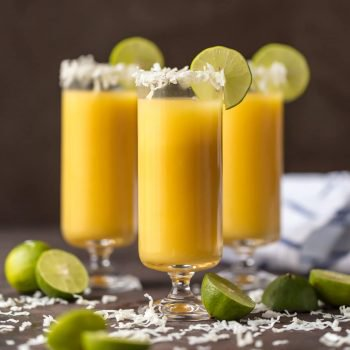 TROPICAL MIMOSAS are the perfect year round cocktail! This delicious mimosa recipe is made with coconut simple syrup, orange, mango, and pineapple juice, and of course champagne. This easy coconut water cocktail is SO TASTY and it will keep you hydrated.
