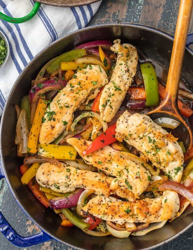 This CILANTRO CHICKEN STIR FRY recipe is an easy, delicious, and HEALTHY dinner you can make in just minutes! So much flavor and none of the fuss. Loaded with chicken, peppers, onions, and cilantro...yum!