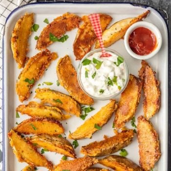 These CRISPY PARMESAN POTATO WEDGES are so absolutely delicious and EASY! You'll never go back to regular fries after you try these thick potato wedges coated in a crispy cheese shell. Just too good!