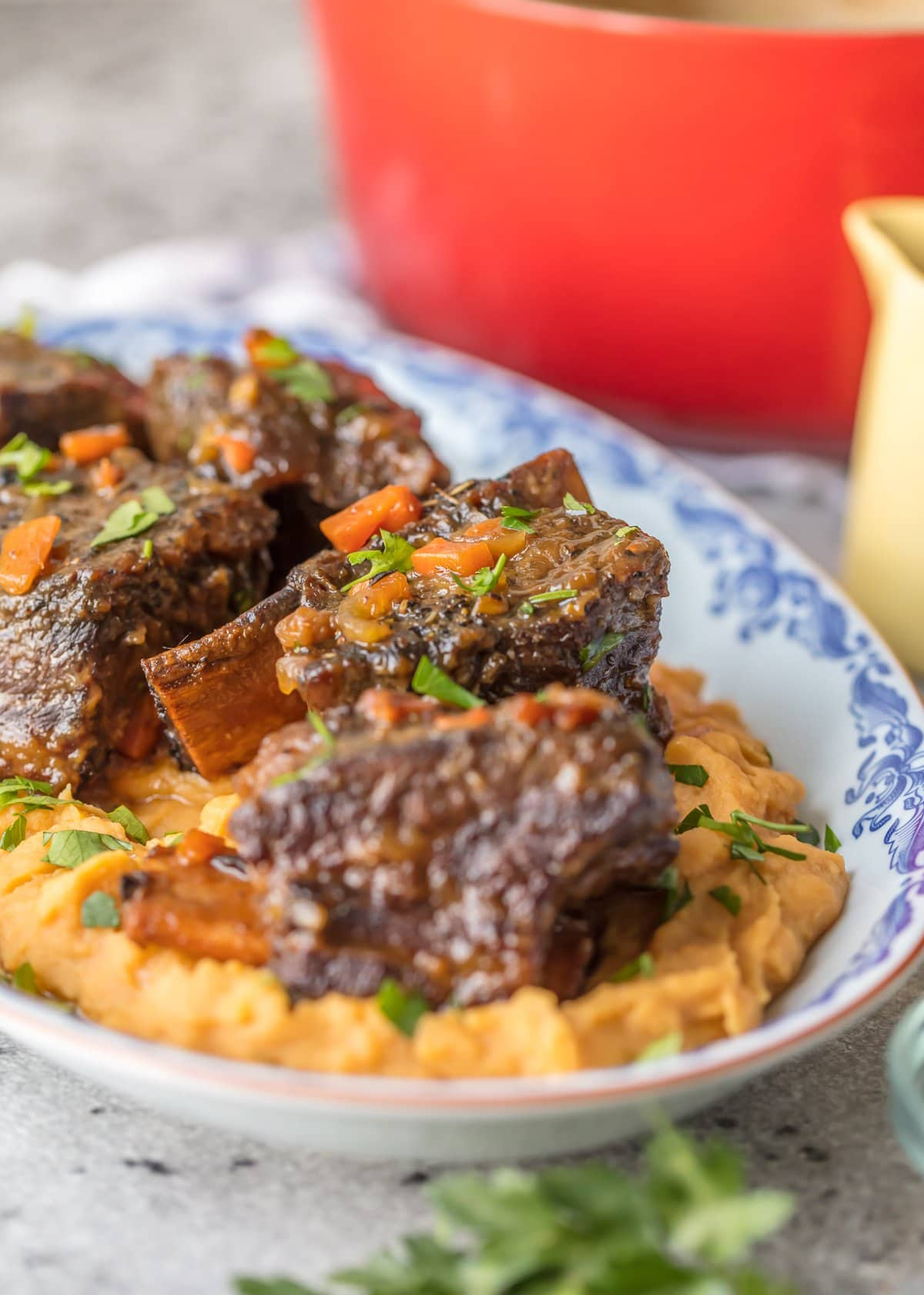 A plate of mashed sweet potatoes and honey bourbon short ribs