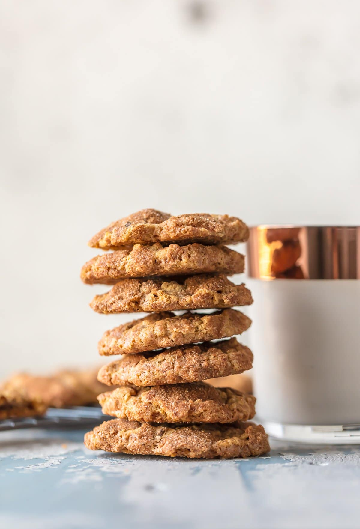 A stack of the best oatmeal chocolate chip cookies next to a glass of milk