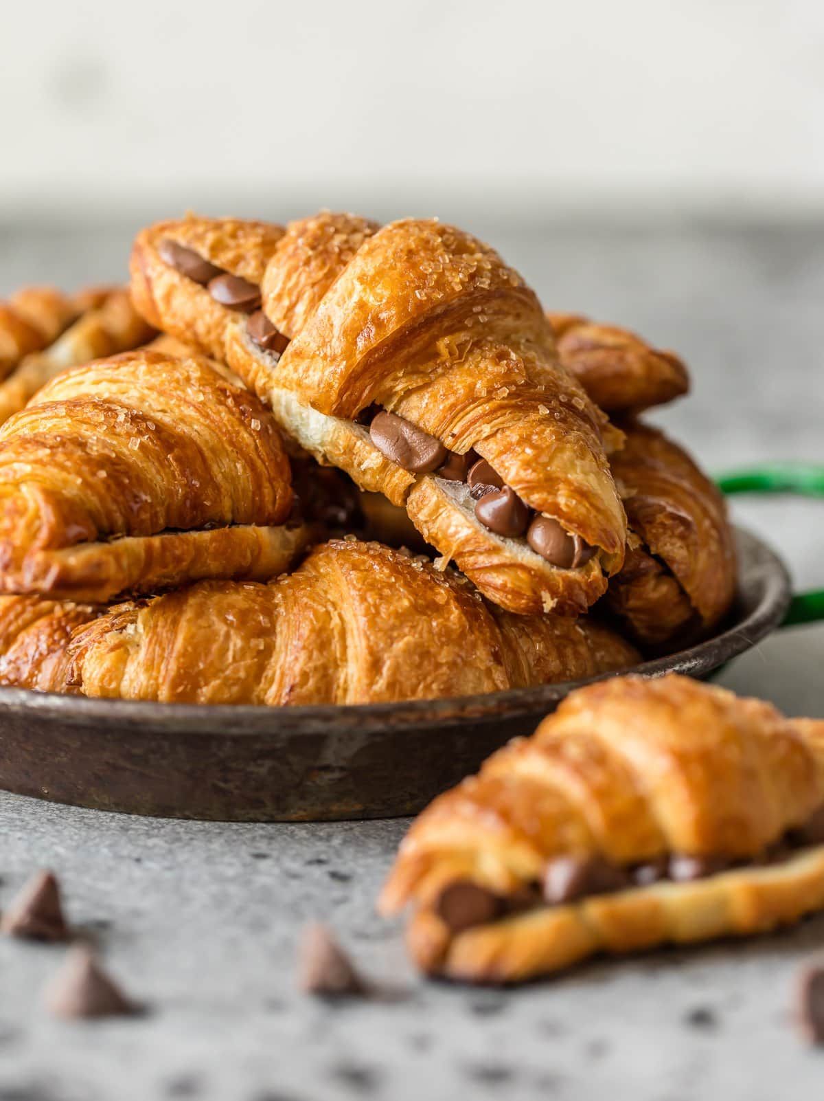 a plate of chocolate croissants