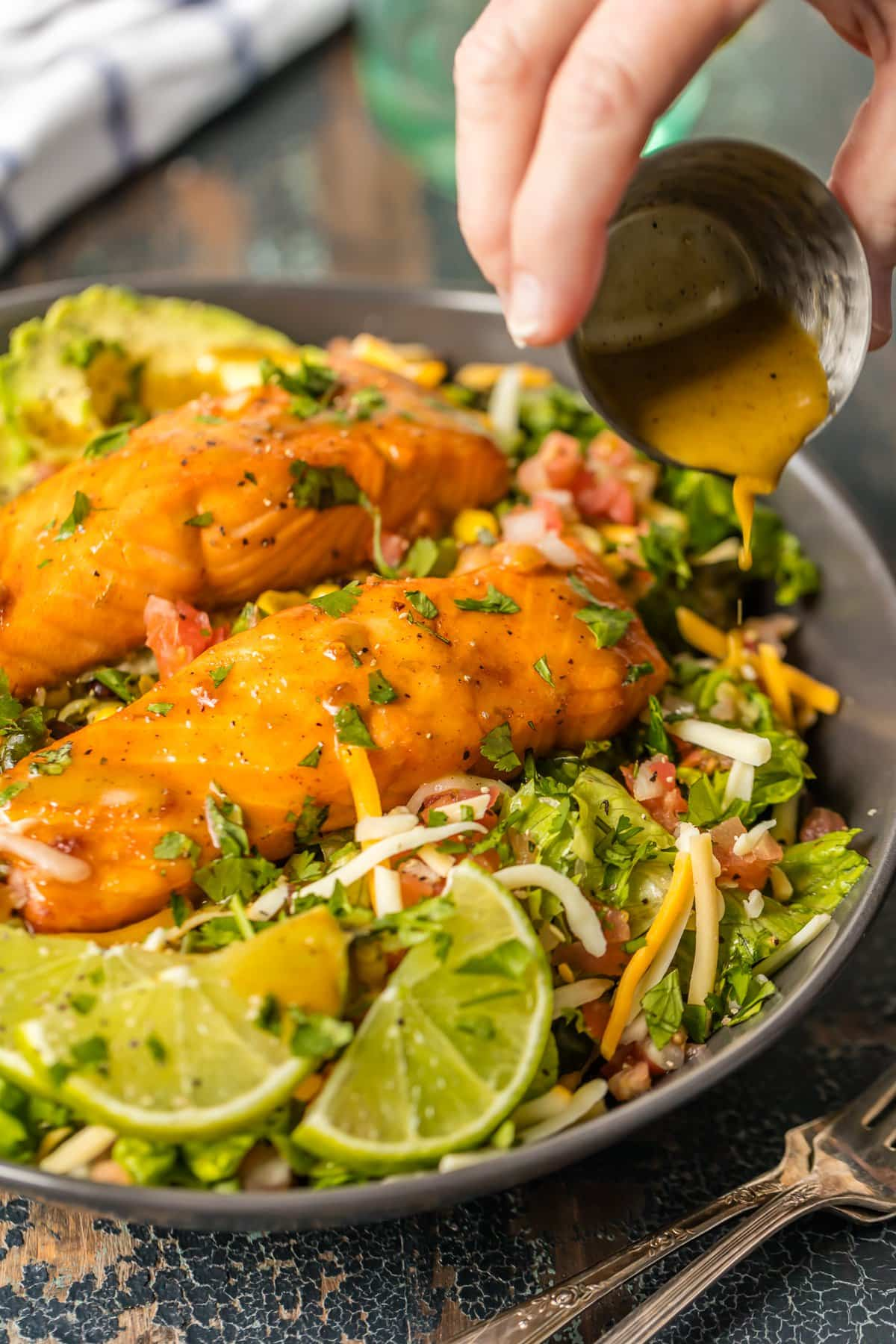 Salmon salad recipe with tomatoes, cheese, black beans, avocado, and more