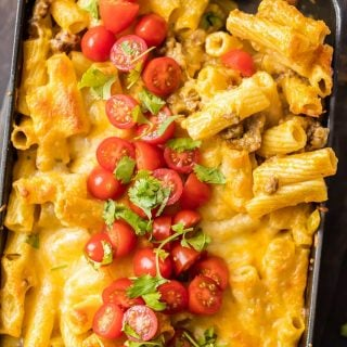 MEXICAN MAC AND CHEESE can't be beat! No need to fool with a tricky cheese sauce when you have this secret ingredient making things extra creamy and delicious. Spicy sausage and green chiles make this baked macaroni and cheese recipe soooo tasty!