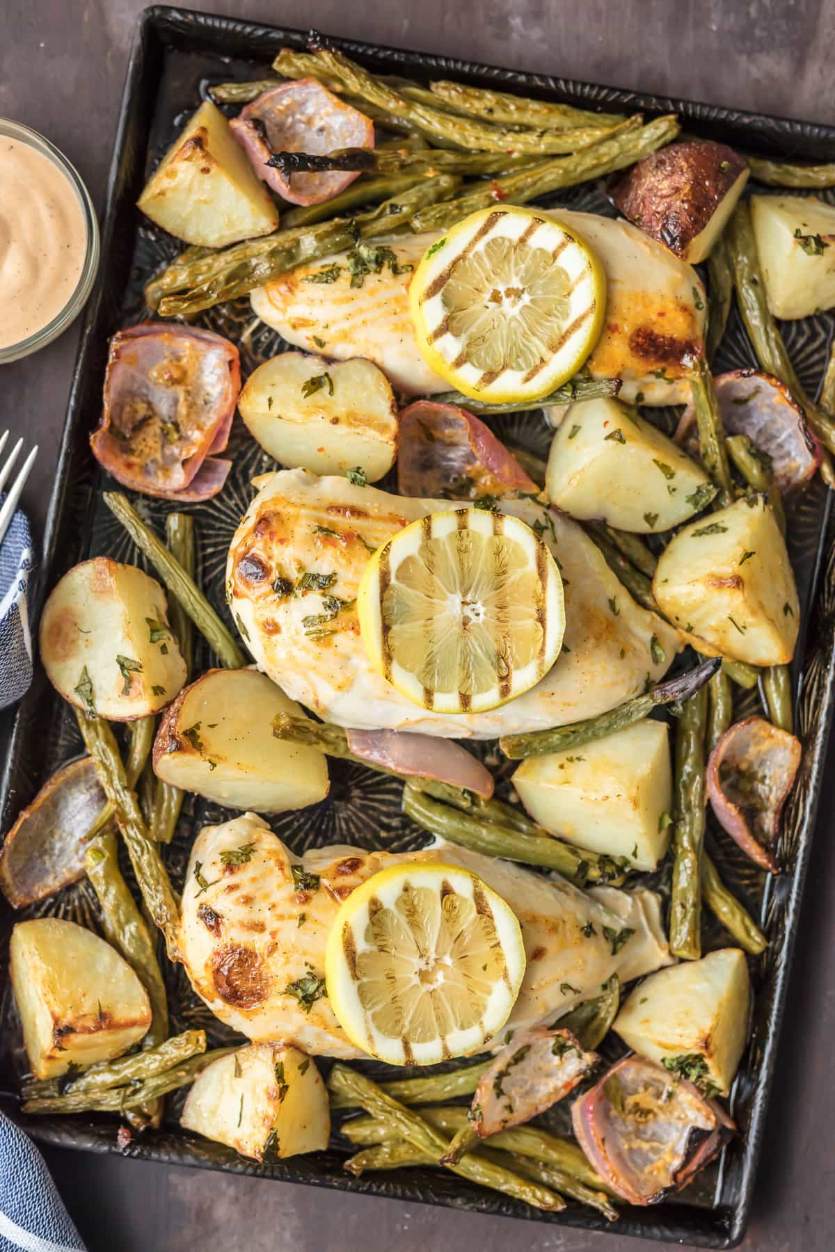 This ONE PAN CHILI LIME RANCH CHICKEN AND VEGETABLES is the absolute easiest healthy dinner recipe out there! Chicken, potatoes, green beans, and onion, tossed in ranch, all cook on one sheet pan. Delicious!