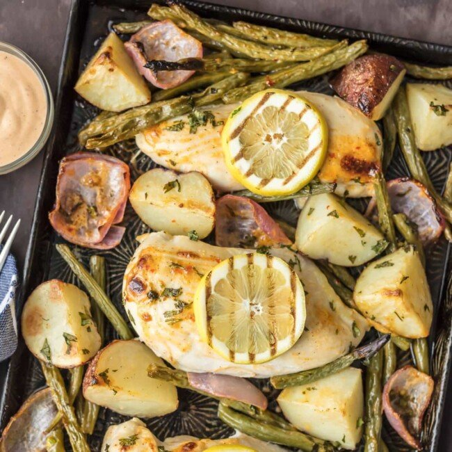 This ONE PAN CHILI LIME RANCH CHICKEN AND VEGETABLES is the absolute easiest healthy dinner recipe out there! Chili Lime Chicken, green beans, potatoes, and onion, tossed in ranch & cooked on one sheet pan.