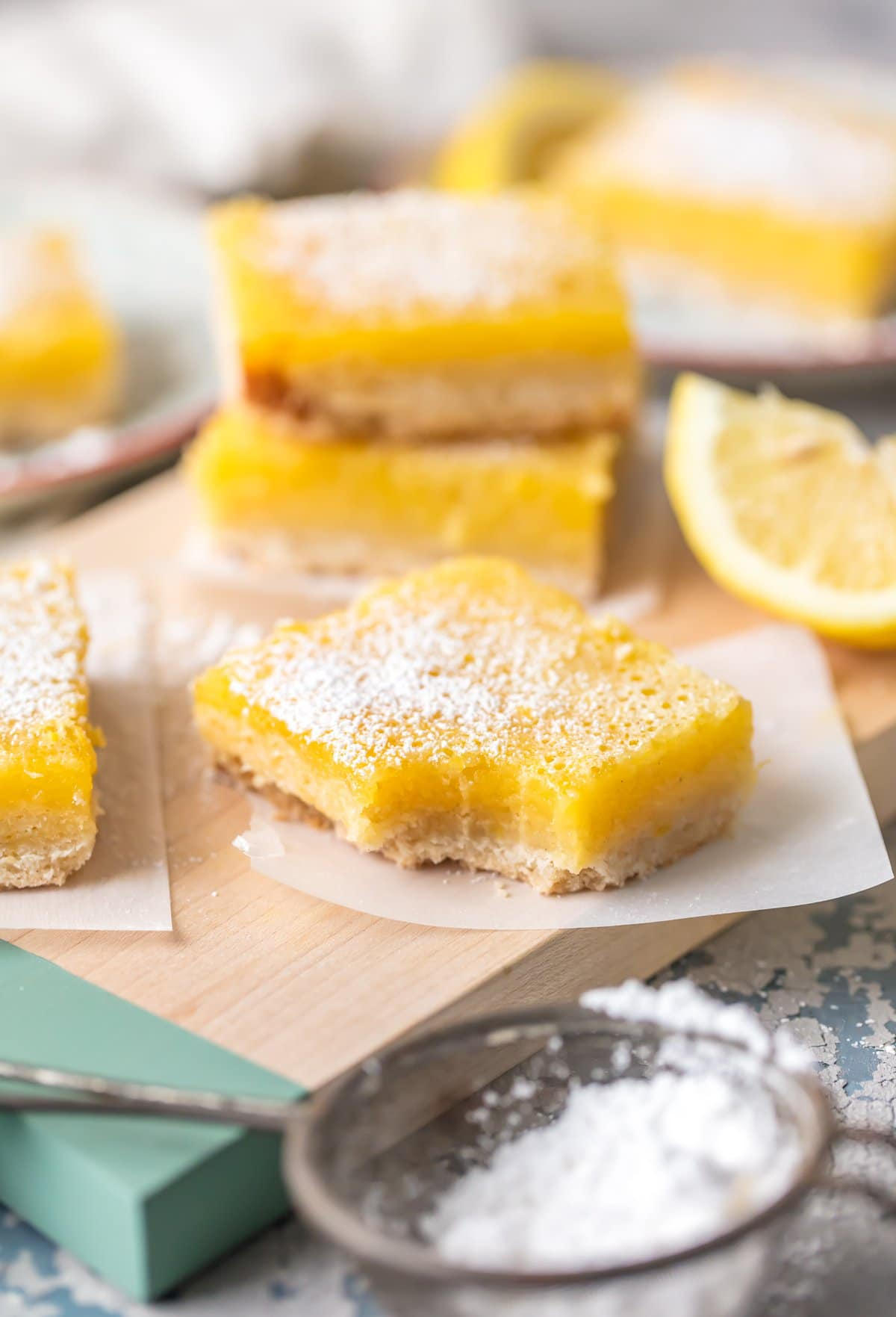 Lemon Bars (Gluten Free Lemon Bar Recipe) are the easiest and best lemon bar recipe, and they just so happen to be gluten free! These Lemon Squares are SO DELICIOUS! These are one of our favorite easy gluten free desserts. Thick, creamy, tart, and utterly delicious; The Best Lemon Bars you'll ever taste.