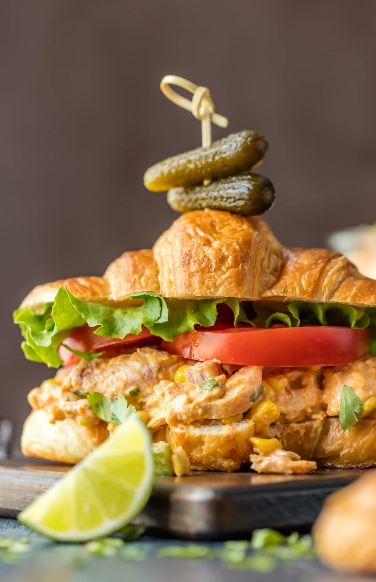 Chicken Salad Sandwich on a croissant with lettuce and tomato