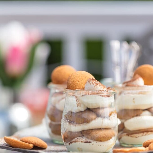 These Easy Tiramisu Cups are made with a secret ingredient, vanilla wafers! This easy tiramisu recipe is perfect for summer parties & BBQs. Easy to make, easy to serve, and easy to eat!