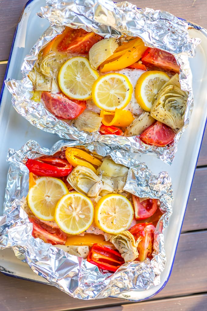Grilled Caesar salmon foil packets on a tray