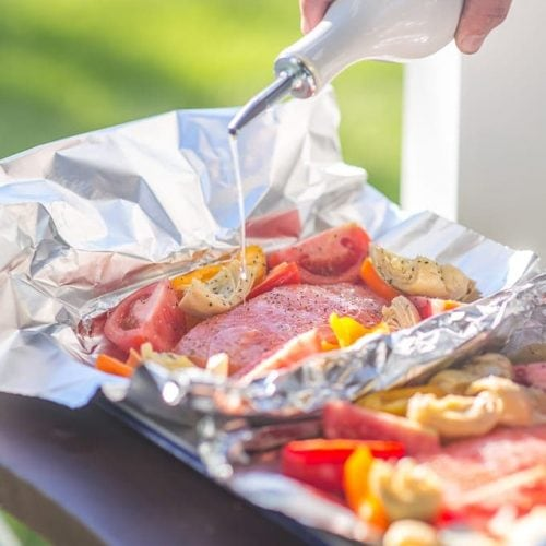 grilled caesar salmon foil packets on table