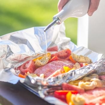 These GRILLED CAESAR SALMON FOIL PACKETS are the perfect way to enjoy seafood on the grill this Summer. Salmon, tomatoes, artichokes, and sweet pepper in foil...grill salmon in foil for the best flavor!