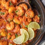chipotle shrimp in skillet with wooden spoon