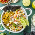 MEXICAN STREET CORN SALSA is my favorite spicy corn dip, just perfect for every occasion! Roasted corn, feta, lime juice, sour cream, cilantro, pico de gallo, and more!