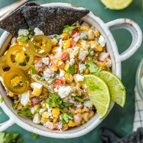 mexican street corn salsa in a bowl with blue tortilla chips