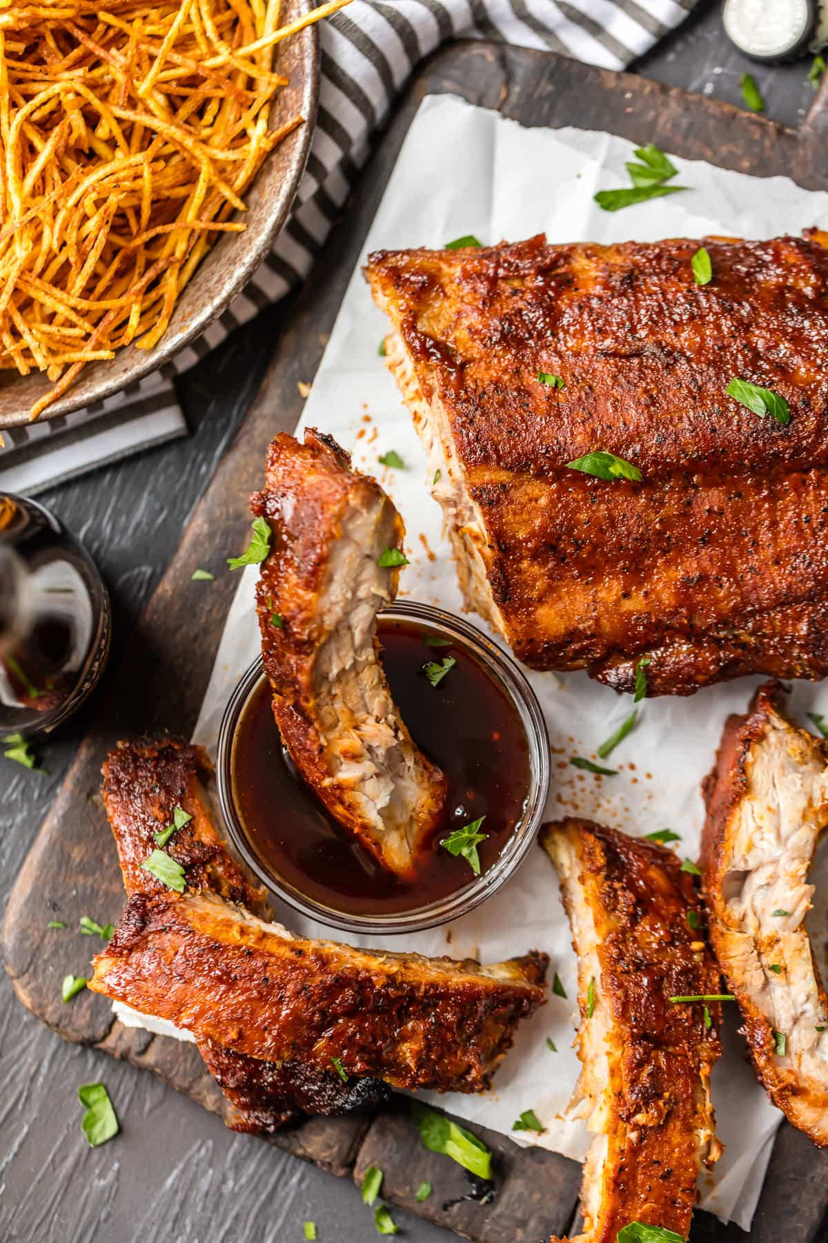 Easy Oven baked ribs, one rib dipped in bbq sauce