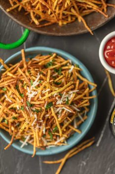 Shoestring Fries are the perfect side for sandwiches to bbq to so much more! We love these fun Shoestring Potatoes that are super thin and deep fried. They're crispy, customizable, and delicious. Once we show you how to make shoestring fries you'll never make fries the same way again. We love to make ours Garlic Parmesan Fries! So delicious and fun.