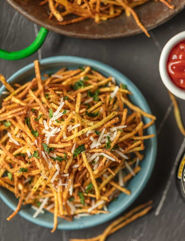 a bowl of shoestring fries