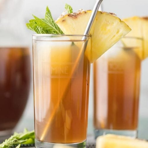 two skinny pineapple sweet teas with straws