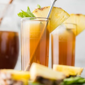 Cheers to Summer with SKINNY SWEET PINEAPPLE TEA! This iced tea recipe is sweetened with a dash of stevia and 100% pineapple juice for just the right guilt-free refreshment on a hot day.