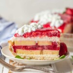 This STRAWBERRY SHORTCAKE PIE is the ultimate Summer sweet treat! Layers of strawberries, cream, and pound cake make for the most delicious (EASY) strawberry pie!