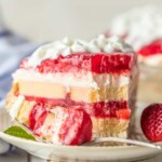 slice of strawberry shortcake pie on a plate with a fork