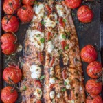 overhead shot of caprese stuffed salmon surrounded by tomatoes