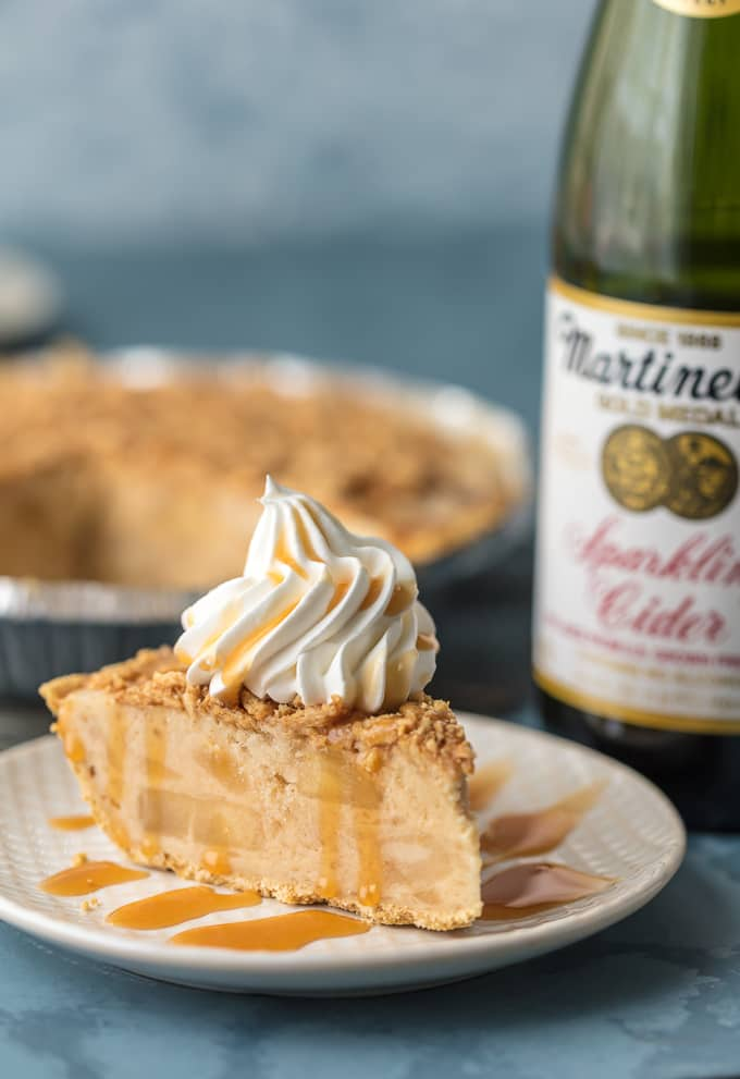 slice of pie in front of bottle of sparkling cider