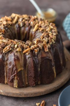 Turtle Brownie Cake is a chocolate lovers dream. Turtle Cake is a dense and moist chocolate brownie cake with walnuts and topped with the most incredible ganache and caramel drizzle. It simply doesn't get better than this Brownie Cake! Crave worthy baking!