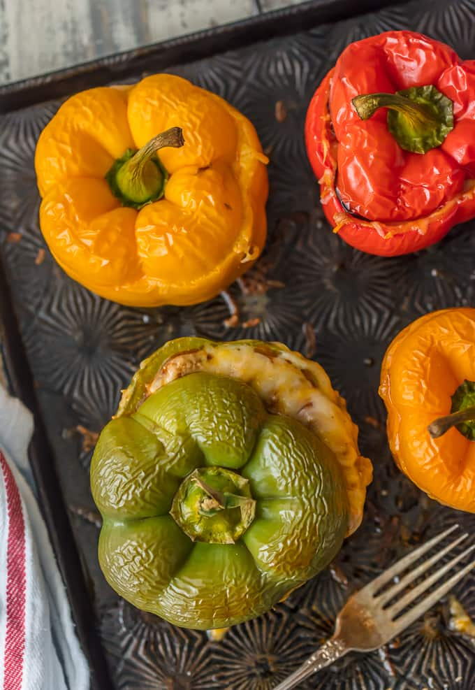 overhead shot of stuffed bell peppers on sheet pan