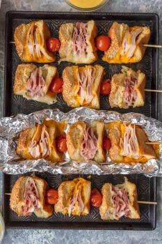 overhead shot of sandwich skewers on pan