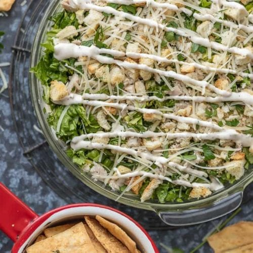 overtop shot of chicken caesar salad dip with crackers