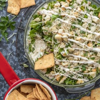 This Caesar Salad Cream Cheese Chicken Dip recipe is the perfect mix of chicken caesar salad and cream cheese dip. The perfect appetizer for parties, serve it with pita chips or veggies!