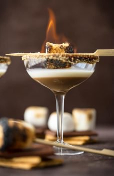 toasted smores martinis with a marshmallow on fire