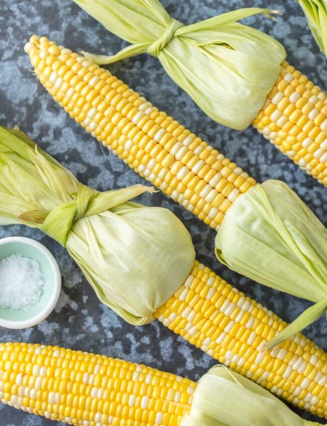 Here is How to Cook Corn on the Cob. The BEST way to cook corn on the cob is by boiling corn on the cob. It's easy and it makes the perfect sweet corn.