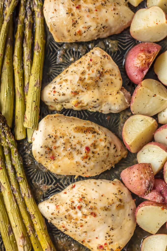This ONE PAN HONEY GARLIC CHICKEN AND VEGETABLES is the ultimate weeknight meal. This easy dinner creates the most tender chicken, potatoes, and asparagus. Bonus, only one sheet pan to clean!