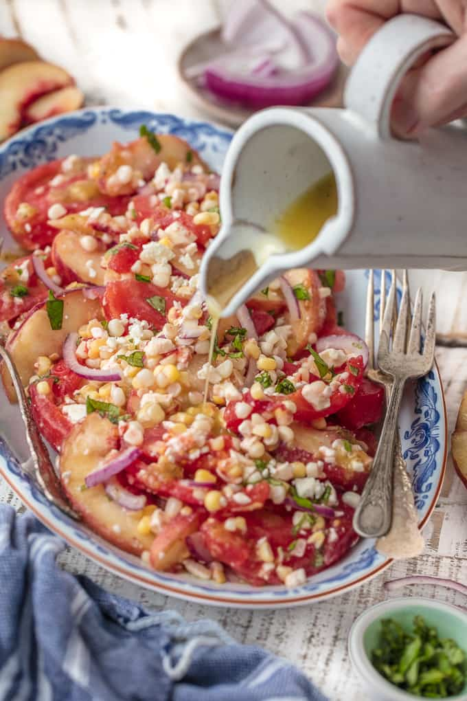This PEACH TOMATO CORN SALAD WITH SPICY HONEY VINAIGRETTE is so fresh, delicious, and easy. Make it as a side or a meal, its delicious throughout the day. SO MUCH FLAVOR.